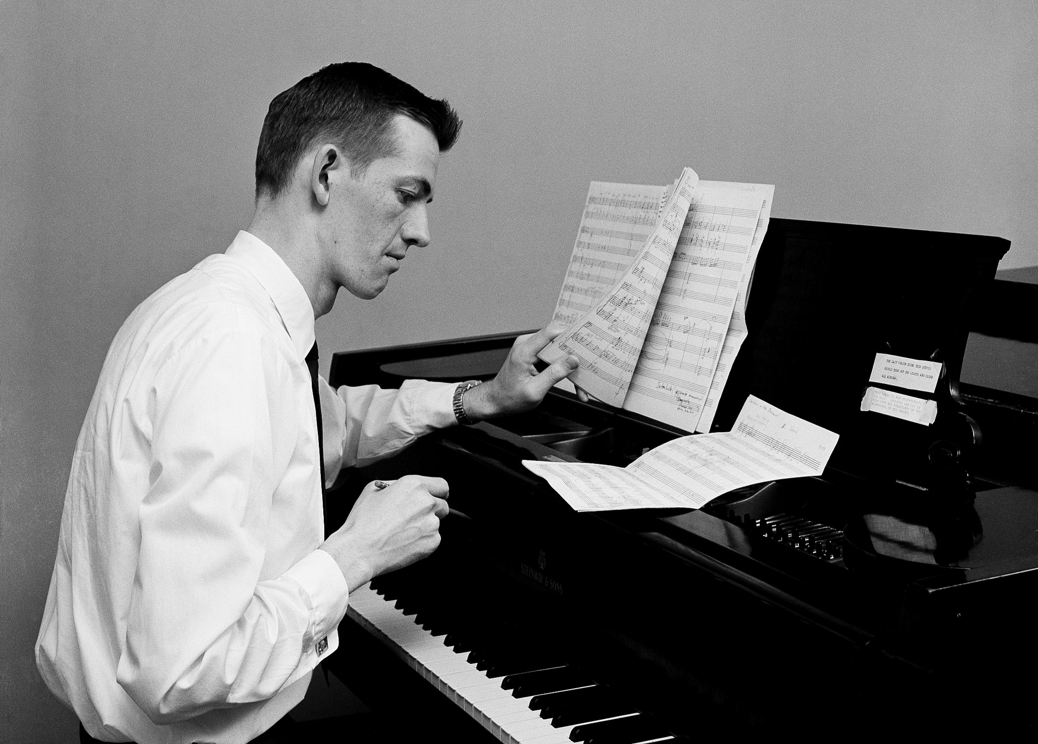 """Dr. Gus composing the opera """"The Hunted,"""" 1960"""